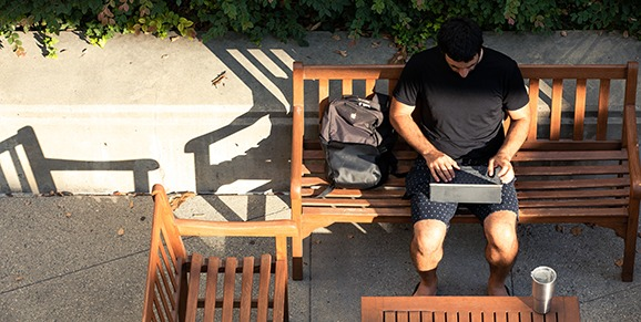 Man on Bench with Laptop
