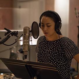 Julie Tai singing