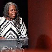 Alexis Abernethy speaking at podium
