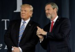 U.S. President Donald Trump (L) stands with Liberty University President Jerry Falwell, Jr. after delivering keynote address at commencement in Lynchburg, Virginia, U.S., May 13, 2017. REUTERS/Yuri Gripas - RC1EE4E00360